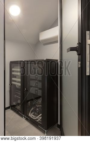 Modern Rack Of Equipment For Internet And Multimedia Devices Installed In Building.