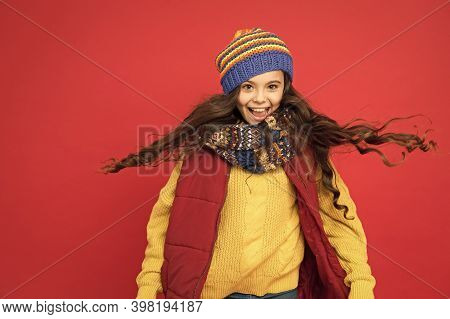 I Just Let My Hair Go. Happy Child With Long Hair. Small Girl Wear Warm Hat On Head. Hair And Beauty