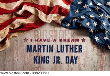 Happy Martin Luther King Day Concept.  American Flag Againt Old Wooden Background