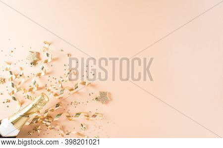 Happy New Year Celebration Background Concept. Champagne With Stars And Christmas Ball On Pastel Bac