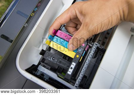 Technicians Are Install Setup The Ink Cartridge Of A Inkjet Printer The Device Of Office Automate Fo