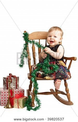 Laughing Christmas Baby With Gifts Rocks In Patchwork Dress