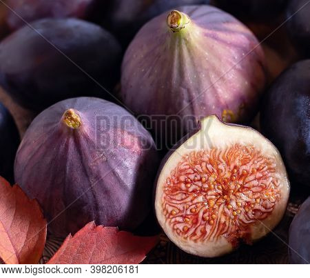 Ripe Figs And Plums On A Platter. Close-up. Picture. Cutting Board.