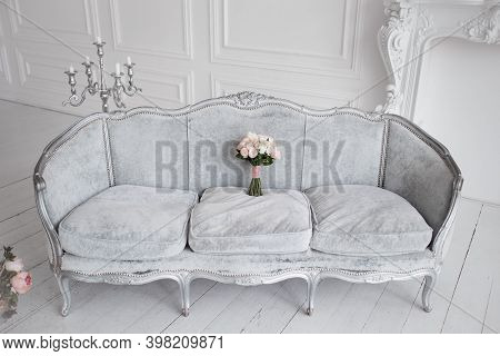 Beautiful Wedding Bridal Bouquet Of Roses On Sofa