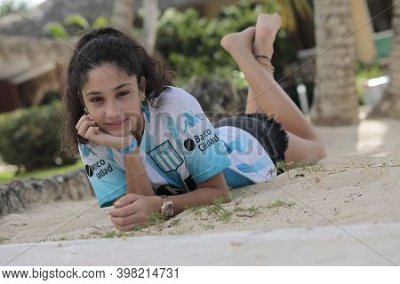 Bayahibe, Dominican Republic 5 December 2020: Little Girl Lying On The Beach