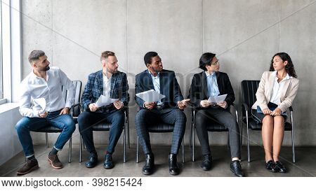 Employment Discrimination. Diverse Businessmen Staring At Lady Applicant Waiting For Job Interview S