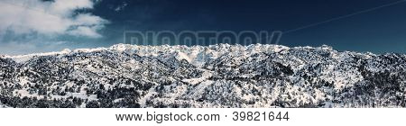 Image of beautiful Faraya mountain, wintertime mountains landscape, peaceful panoramic nature, cold snowy winter weather, land covered with white snow, Christmastime season, Xmas holiday