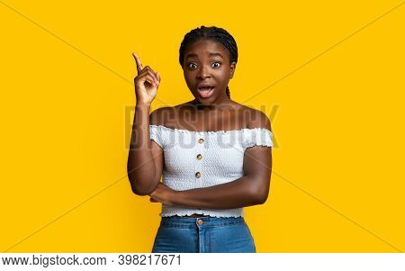 Great Idea. Excited Black Millennial Lady Pointing Finger Up Having Inspiration Or Eureka Moment, Sm