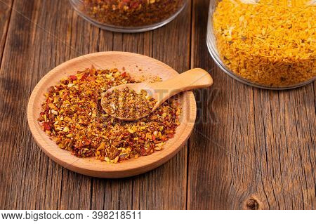Spice Mix In A Plate Close-up. Spices On A Wooden Table. Spice For Cooking.