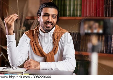 Online Education. Indian Male Teacher Recording Educational Video Talking To Camera Making Lecture T