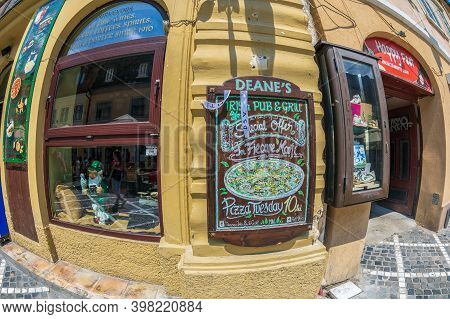 Brasov, Transylvania, Romania - July 12, 2020: Small Shops And Restaurants Located On The Picturesqu