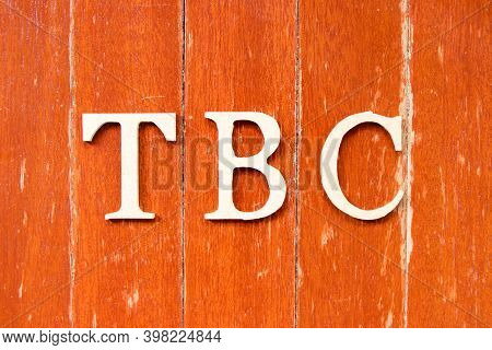 Alphabet Letter In Word  Tbc (abbreviation Of To Be Confirmed Or Continued) On Old Red Color Wood Pl