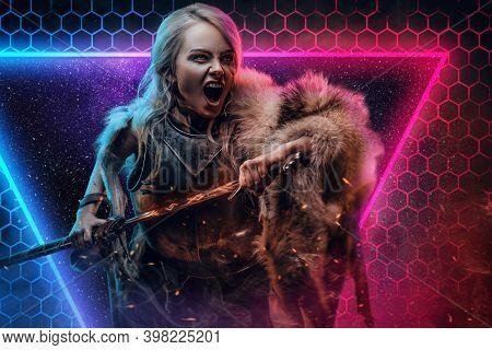 Savage And Violent Female Battle Mage In Heavy Armour With Fur Pulls Out Her Sword From Its Scarrabs