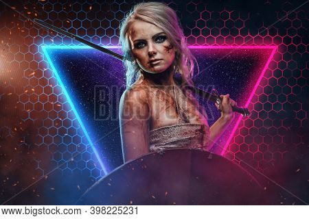 Gray Haired And Charming Female Fighter And Sorcerer Poses In Abstract Background Holding A Sword On