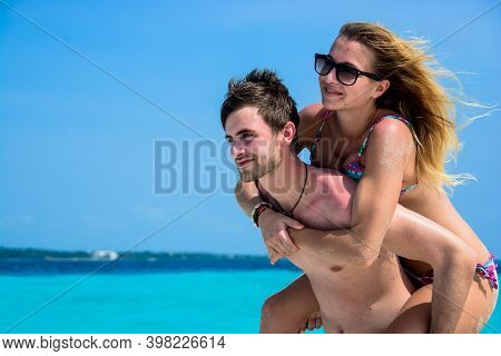 Happy Couple Of Young People On Vacation In The Beach