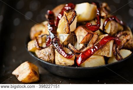 Close Up Of A Pan Of Spanish Fried Potatoes With Capsicum And Onions