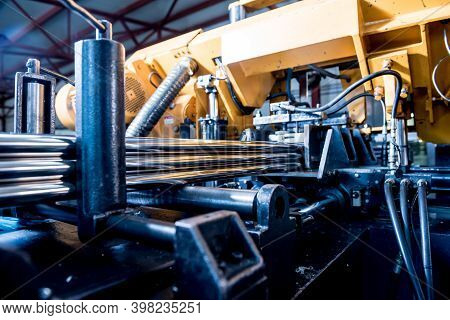 Automatic Band Saw Machine With Water Coolant Cutting Metal Pipes.