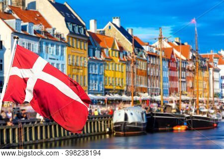 Copenhagen Iconic View. Famous Old Nyhavn Port In The Center Of Copenhagen, Denmark During Summer Su