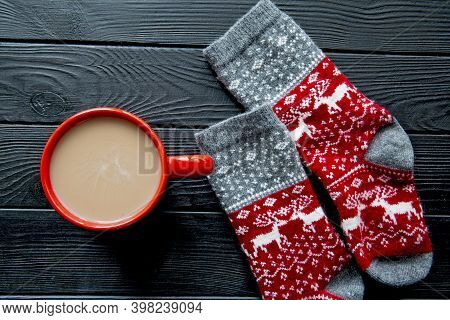 Tasty Hot Chocolate In Red Festive Cup And Socks With Christmas Ornament And Deers On Wooden Backgro