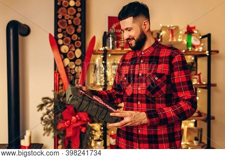 Christmas Young Man, With A Christmas Present At Home In A Christmas Interior, Christmas