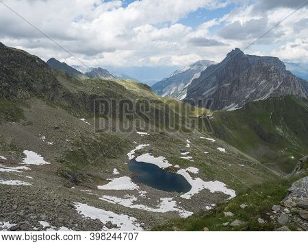 View On Alfairsee Blue Mountain Lake And Innsbrucker Hutte Mountain Hut With Moutain Peak Panorama A