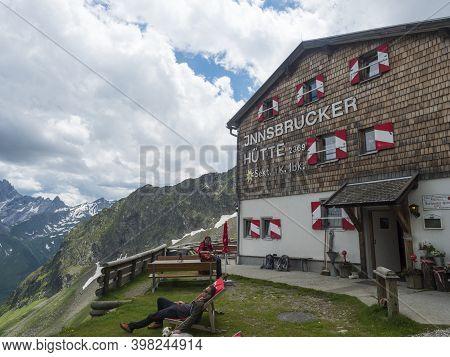 Stubai Valley, Innsbruck-land, Tirol, Austria, July 6, 2020: Hiker People Resting At Terrace Of Inns