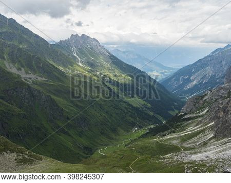 View From Pinnisjoch Saddle On Stubaital Valley And Snow-capped Moutain Panorama At Stubai Hiking Tr
