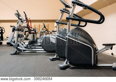 Bright Gym. Sports Equipment In The Gym. Bars Of Different Weights On The Rack.trainers