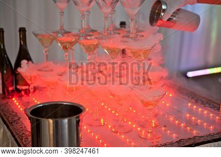 Pyramid Of Glasses Of Champagne. Drinks At The Party. Crystal Glasses For Holiday, A Lot Of Glasses