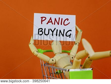 Panic Buying Time. White Sheet Of Paper. Words 'panic Buying'. Wooden Model Of A Human In A Shopping