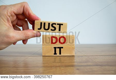 Just Do It Symbol. Male Hand Placing A Block On Top Of A Blocks Tower With Words 'just Do It'. Beaut