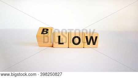 Low Blow Symbol. Turned A Cube And Changed The Word 'low' To 'blow'. Beautiful White Background, Cop