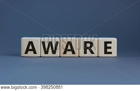 Aware Symbol. Wooden Cubes With The Word 'aware'. Beautiful Grey Background. Business And Aware Conc