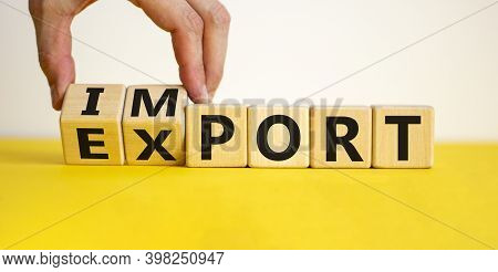 Import Or Export Symbol. Hand Is Turning A Cube And Changes The Word 'import' To 'export'. Beautiful