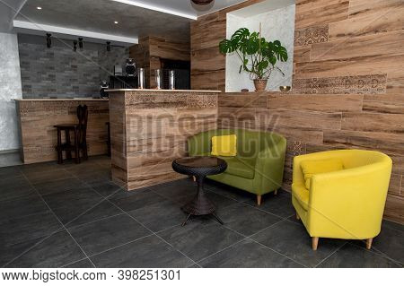Designer Furniture Yellow Armchair, A Chair Next To A Green Sofa, A Sofa Next To Two Bar Counters Wi