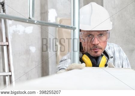 Man Work, Professional Construction Worker With Scaffolding, Safety Hard Hat, Hearing Protection Hea