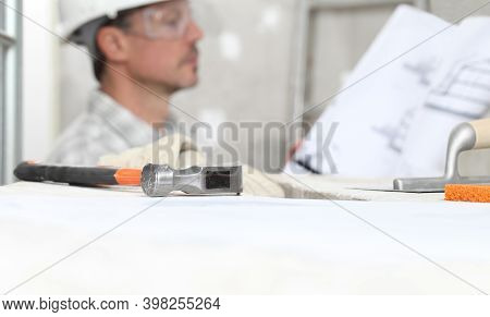 Man Work, Professional Construction Worker Looking At Blueprints On Interior Building Site, Wear Saf