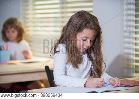 Kid In Classroom At School. Happy Schoolchild Sitting At Desk, Class. Education, Elementary School,