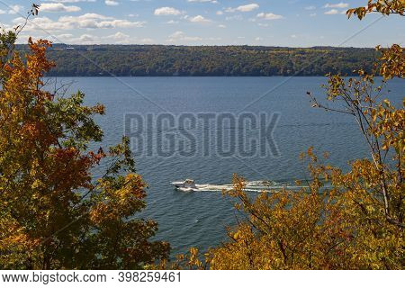 Watercraft Navigate The Waters Of Cayuga Lake, Which Is One Of The Finger Lakes In New York State, D