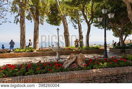 Mijas, Spain - May 22, 2017: People Enjoy Panoramic View Of  Mediterranean Sea From The Terrace In T