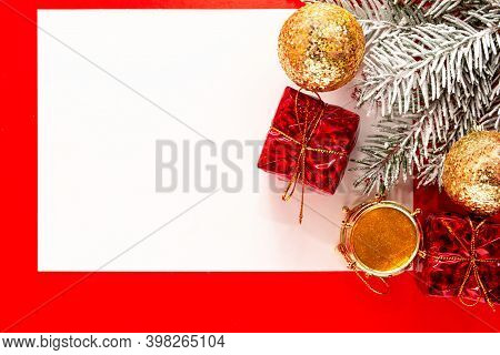 Creative Layout Made Of Christmas Tree Branches With Paper Card Note. Christmas And New Year Concept