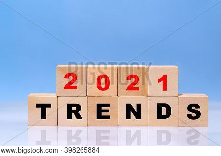Wooden Blocks With The Word Trends 2021. Popular And Relevant Topics. New Ideological Trends Of Fash