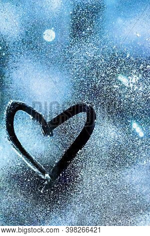 A Heart Painted On Frozen Glass With Blue Background