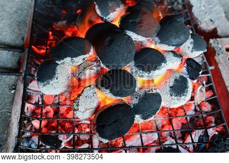 Ember Under Grill, Semi-glowing Coal Briquettes On Grill, Bbq Preparation Almost Finished; Horizonta