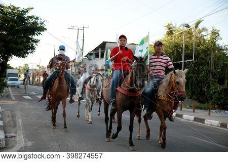 Mata De Sao Joao, Bahia, Brazil - November 10, 2020: People Are Seen Riding On Horseback During A Wa