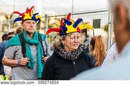 Tenerife, Spain - 09-02-2016: Tenerife Carnival - A German Tourist Couple With A Joker Hat.