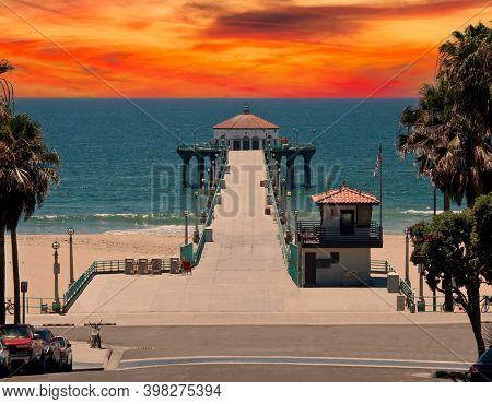 Manhattan Beach pier with sunset sky in the South Bay region of Los Angeles County, California.