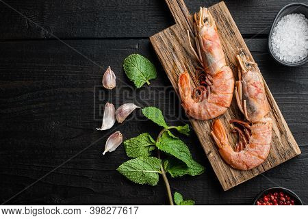 Seafood Scampi On Wooden Board Over Black Wood Table, Flat Lay With Copy Space