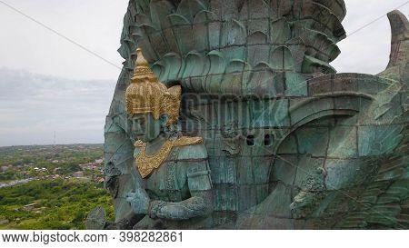 Garuda Wisnu Kencana Statue Close Up Of His Face And Hands