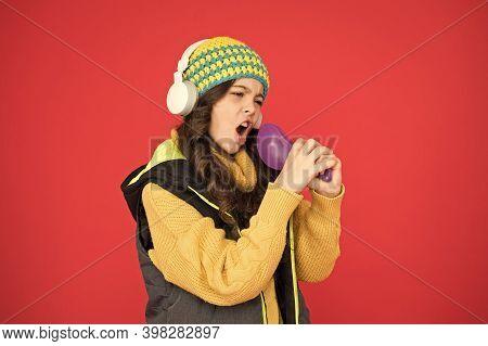 Pretending Superstar. Voice Synthesis Change Music Distribution. Small Girl Listening Music Headphon